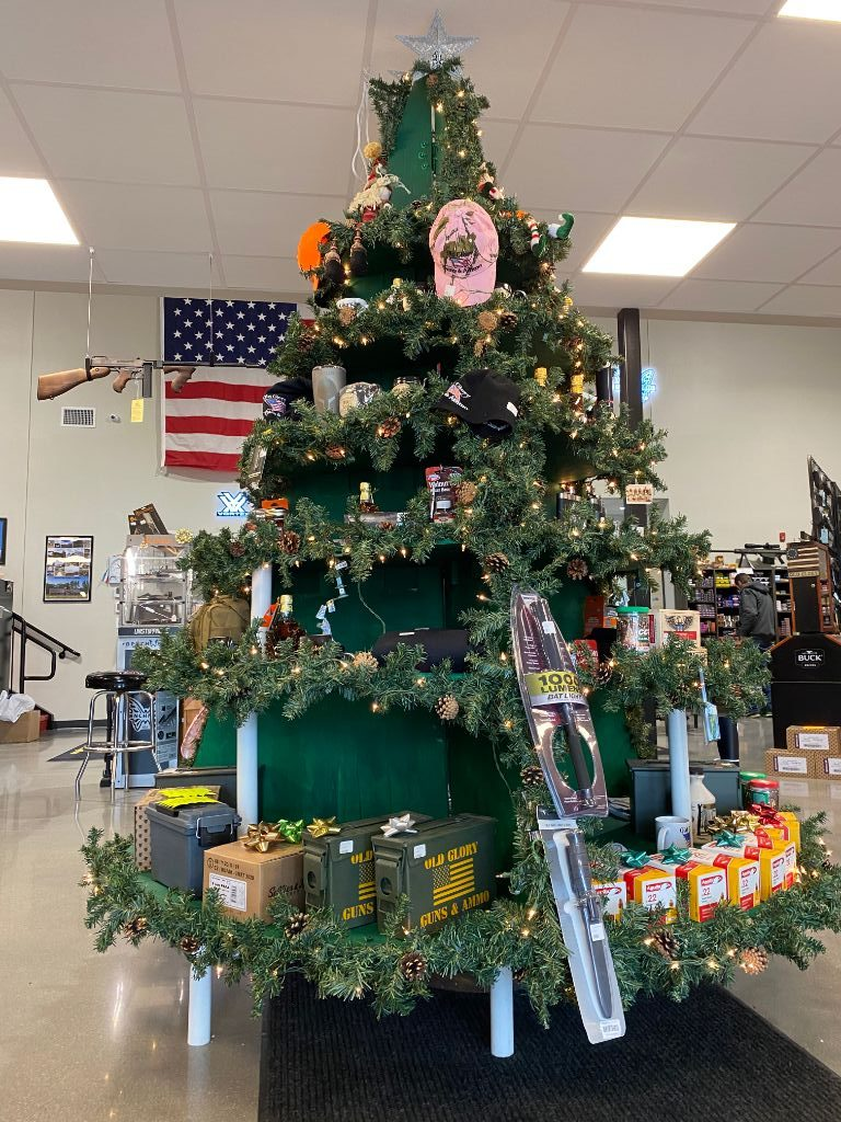 A Christmas tree display in Old Glory Guns & Ammo in Greenville NH