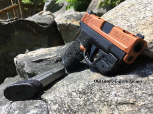 Ported Shield 40 with some custom copper Cerakote and grip texturing.
