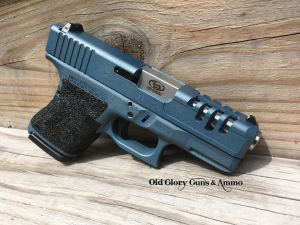 Glock 29 with some slide lightening, barrel upgrade, recoil spring upgrade, grip texturing, and Blue Titanium Cerakote.