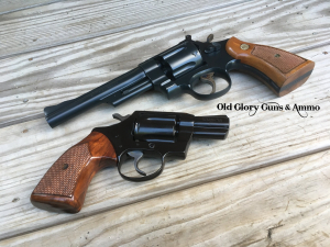 A pair of refinished revolvers, the Smith is done in Midnight and the Colt is done in Gloss Black