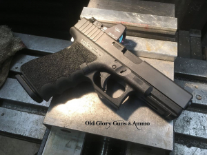 Glock 23 with RMR cut and grip texturing. Kept the finger grooves and did a trigger guard undercut.