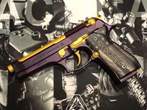 Custom Beretta.We made and raffled this pistol off and donated the proceeds to the Milford VFW and New England Clear Path for Veterans in honor of National PurpleHeart Day.  I want to send out a very special thanks to Bonnie Draper forher very generous donation toward this project. - Dana