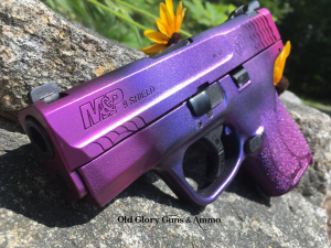 A S&W Shield 2.0 with some extreme Cerakote, some color shift blue/purple with purple night shade candy.